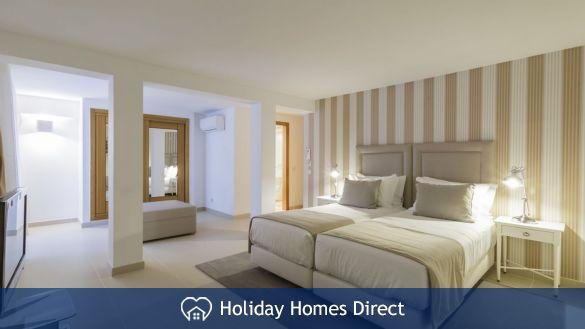Dual bed bedroom in Crest-Villas-Almancil