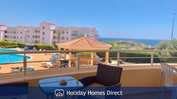 Superb pool and sea views from lounge veranda