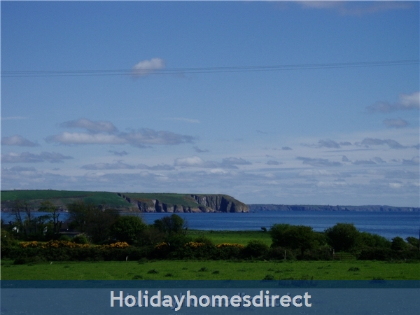 Ballinacourty Thatch Cottage: Clonea Beach view from garden
