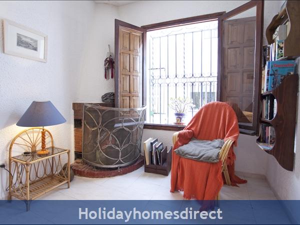 Pueblo Andaluz: Living room fire place