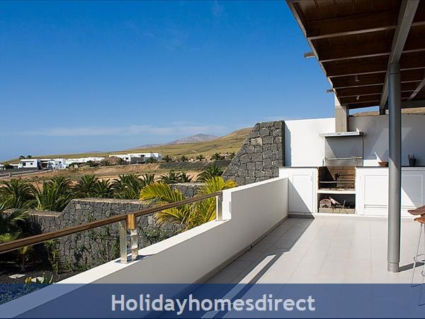 Buena Vida With Private Pool, Puerto Calero, Lanzarote: Barbecue terrace and view