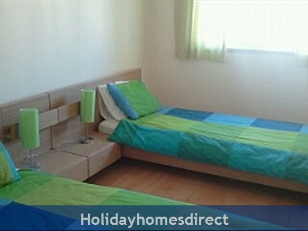 Spacious 3 Bed Alvor Apartment Alvor Apartment With Wifi, Aircon, Smart 50: Twin Bedroom with built in wardrobe, aircon etc