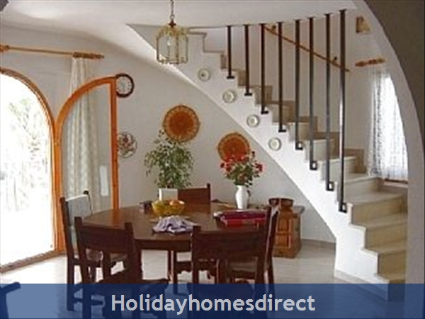Beautiful Villa With Private Pool, Mountain And Sea Views: Dining area with stairs leading to master suite
