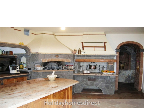 Kitchen with pizza/bbq area equipped