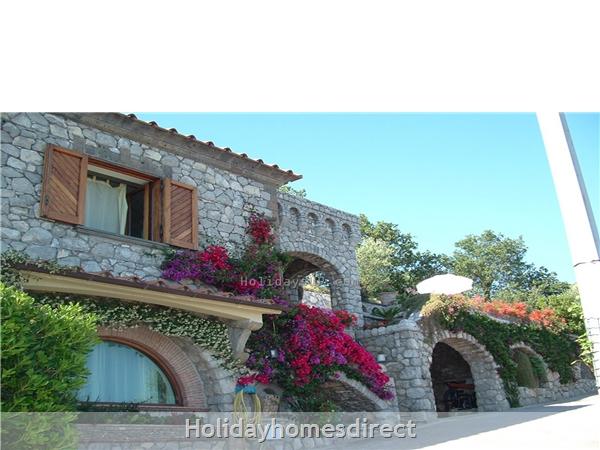 Villa Esp outside rock in Sant'agata sui due Golfi