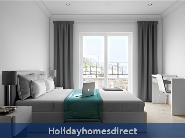 Master bedroom with PC in salema beach village