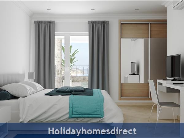 Double bedroom with tv in salema beach village