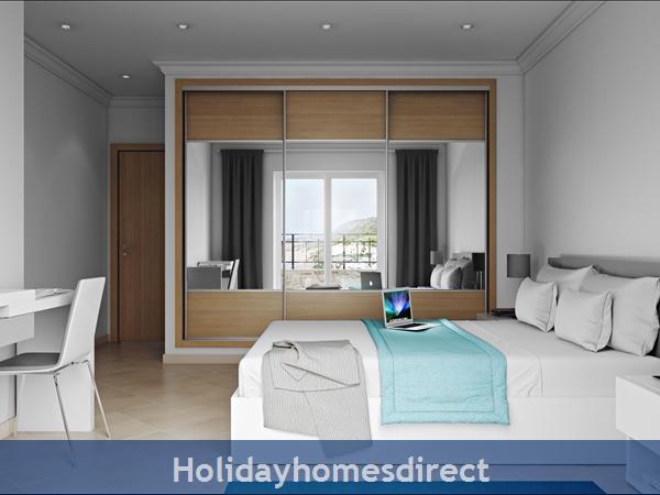 Master bedroom with desk in salema beach village