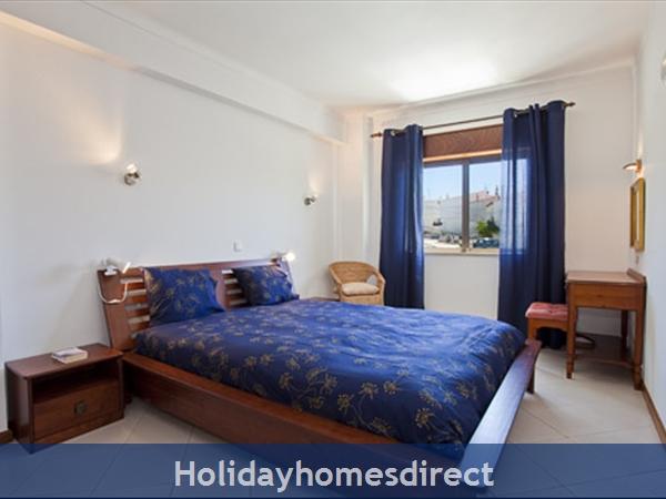 Apartment Aurora Mar 7, Carvoeiro, Algarve, Portugal: master bedroom+space xtra bed/cot
