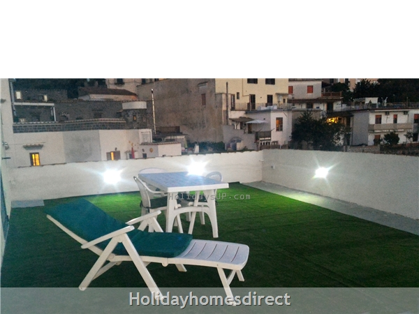 Shared top terrace with solarium-shower at villa