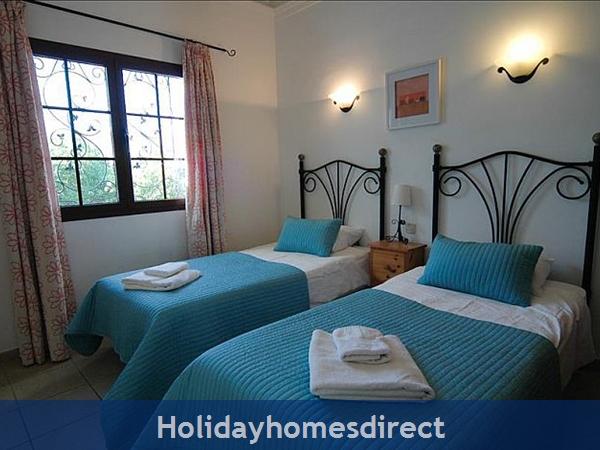 Villa Blanca spare beds in bedroom