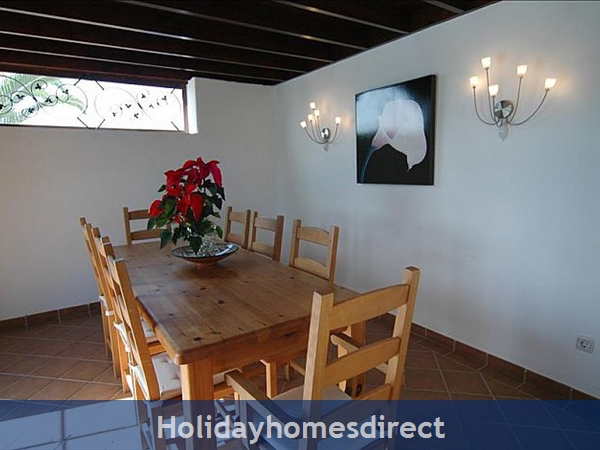 Villa Blanca Dining table and artwork