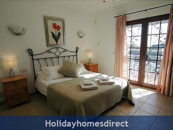Villa Blanca king bed in bedroom