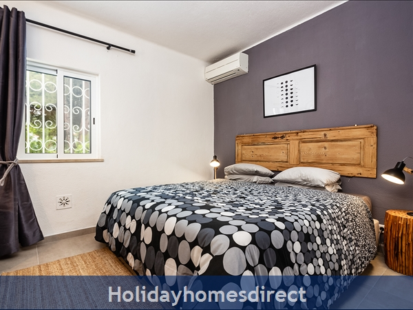 Second bedroom with large king size bed